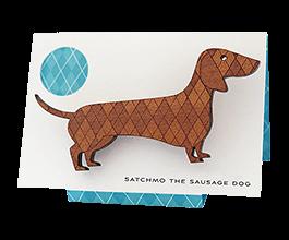 Sausage Dog brooch in Tasmanian Myrtle wood with a delicate laser-engraved argyle pattern. (thumbnail image)