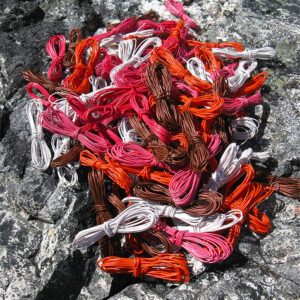 Wire coils (white, orange, pink, brown) for Michele's Fab 40 Basket, taken on a lichen-covered rock at Mt Bowes in Tasmania.