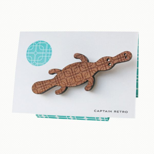 Duck-billed platypus brooch in Tasmanian Myrtle wood veneer with a delicate laser-engraved retro pattern of overlapping squares