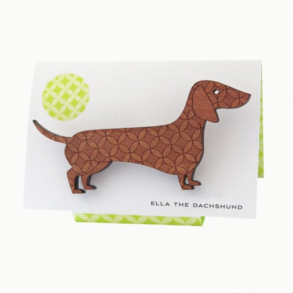 Sausage Dog brooch in Tasmanian Myrtle wood with a delicate laser-engraved pattern of overlapping circles.