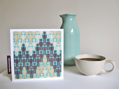 Greeting card with a turquoise background showing a pattern of people with coffee bean heads, next to a turquoise vase and cup of coffee.