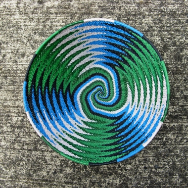 The inside of a Jane's telephone-wire basket photographed from above, showing the chevron pattern for the sides blending into a spiral colours at the base.