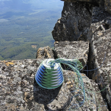 Telephone-wire basket in progress, on the dolerite rocks of the peak of Mt Field West, Tasmania.