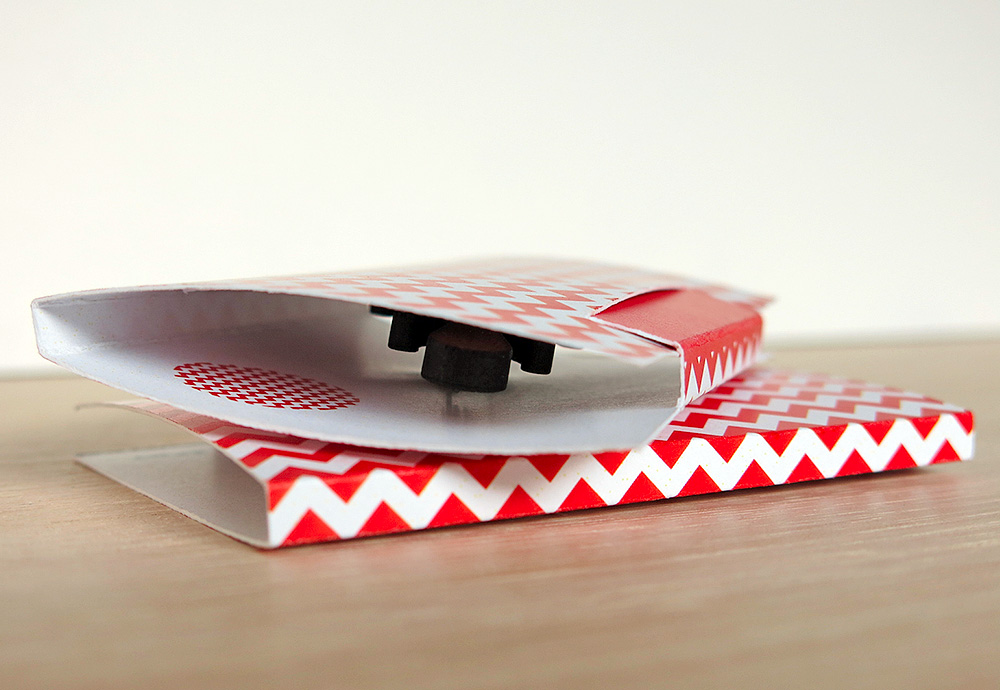 The easel stand for my brooches folds into a sweet little chevron patterned red and white gift box