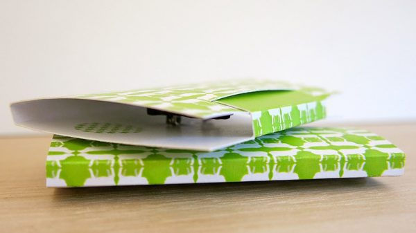 The easel stand for my brooches folds into a sweet little gift box with a bright green and white pattern
