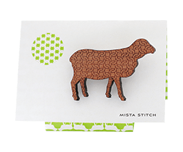 Sheep brooch in Tasmanian Myrtle wood with a delicate laser-engraved chunky knit pattern