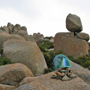 Telephone-wire basket sitting on top of a cairn in front of Rocking Stone on Mt Wellington, Hobart, Tasmania.