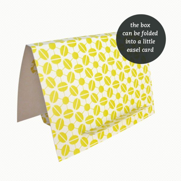 The brooch gift box can be folded out into an easel card with a matching pattern in yellow and white.
