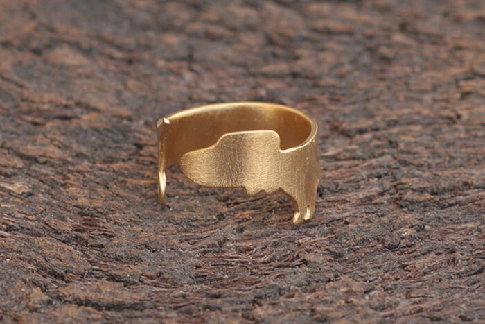 Adjustable gold-plated brass Wiener dog ring in a streamlined, minimalist design by meytalbarnoy on Etsy