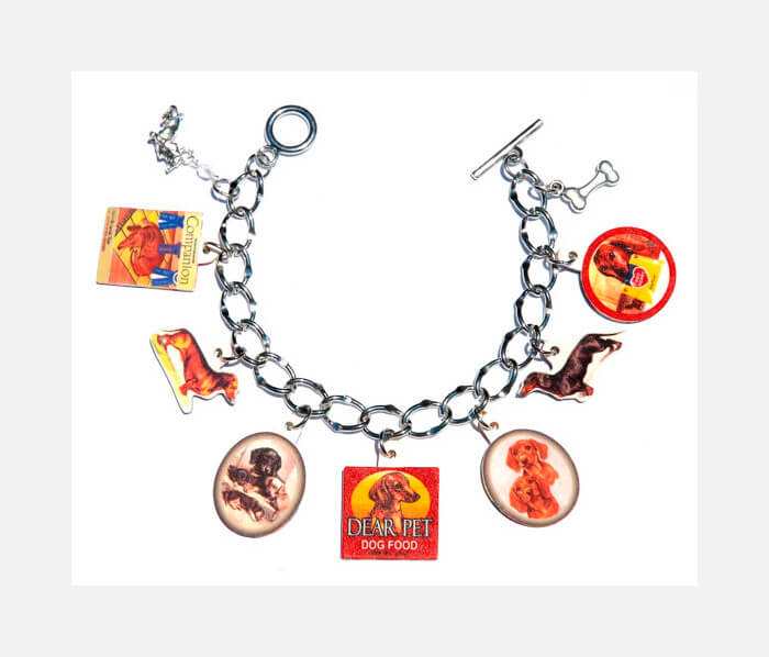 Handmade Dachshund Dog Charm Bracelet featuring altered vintage art and pewter charms by FairystoneCrafts crafts